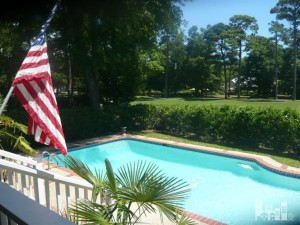 The backyard includes an inviting pool with a perfect view of the Dye Golf Course