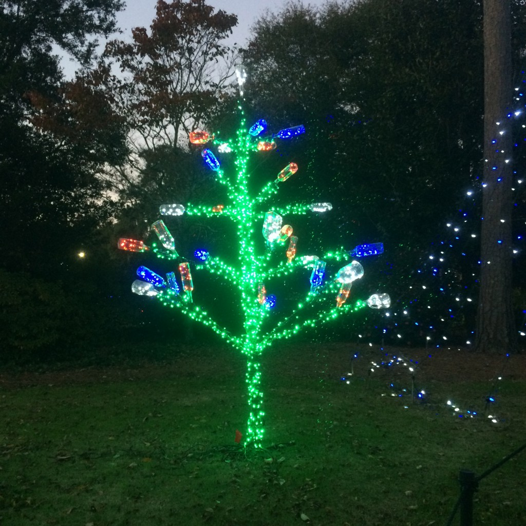Tree decorated in lights and recycled glass bottles