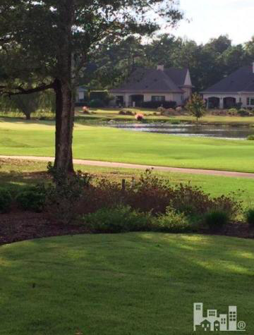 View from the back of the house of the Nicklaus Golf Course and lake
