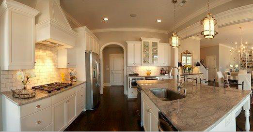 Open kitchen leading into dining room