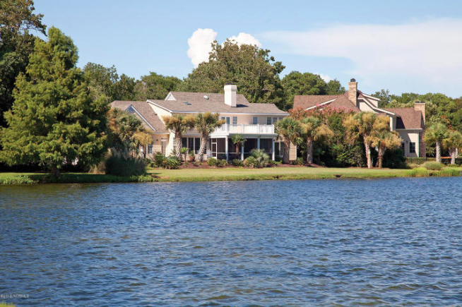View of the back of the house from across the lake